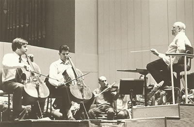 cellists Honigberg and Teie performing the Ott Concerto under the direction of Rostropovich